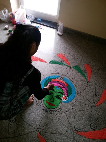 Oneindia Onam 2013 Rangoli -adding colors to face