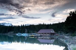 Cabin mountain lake forest. Photographer Blake Verdoorn