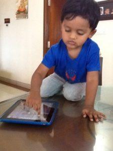 A 2 year old using iPad comfortably