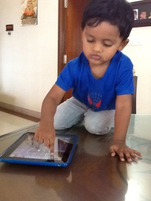 A 2 year old using iPad comfortably
