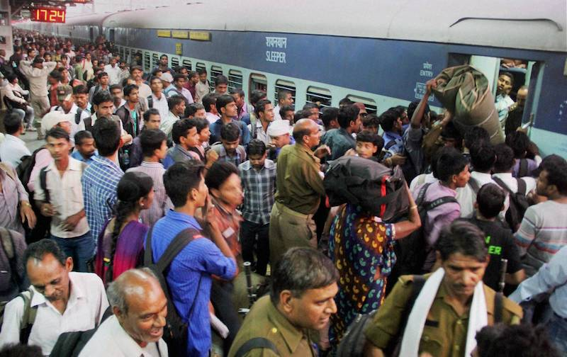 Allahabad: Candidates board a train after appearing in Railway Recruitment Boards (RRBs)-2014 exam at Allahabad Railway Station on Sunday.