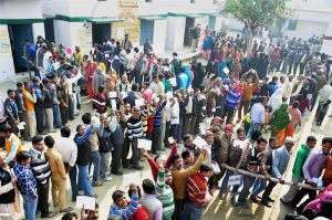 Voters stand in queue to cast their vote during the second phase of UP assembly polls in Moradabad. Source PTI